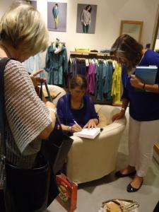 Barbara Lambert signing copies of the Whirling girl at the Eileen Fisher Reading