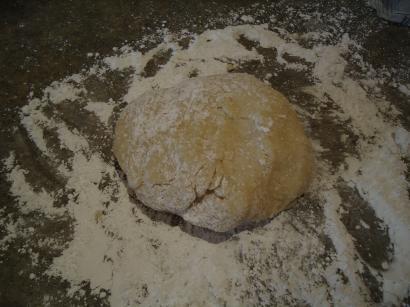 Ball of marzapane dough on floured counter