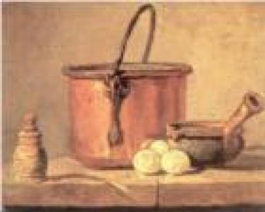 Pot with mortar and pestle and potoatos on table