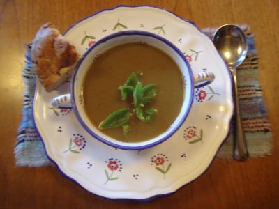 Bowl of Watercress Soup with a garnish of watercress on top.